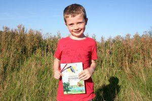 Kilkenny Wildlife Detective - Boy holding the Kilkenny Wildlife Detective Notebook