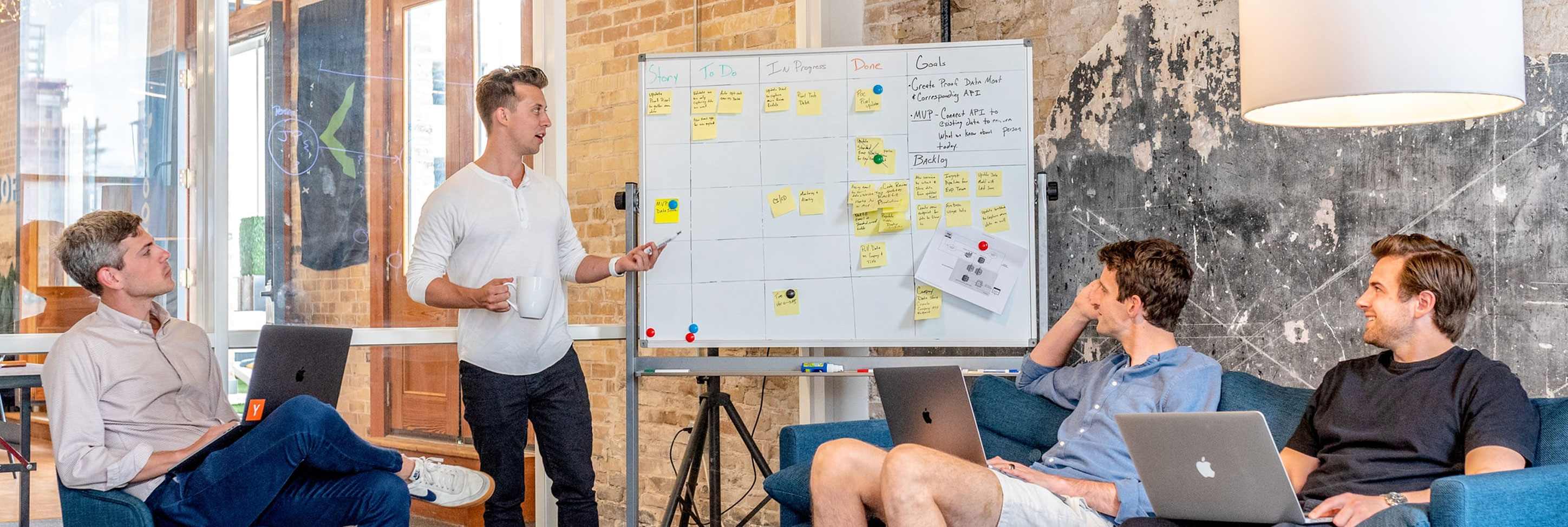 Image of a meeting with a whiteboard