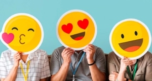 People wearing social media emoji masks