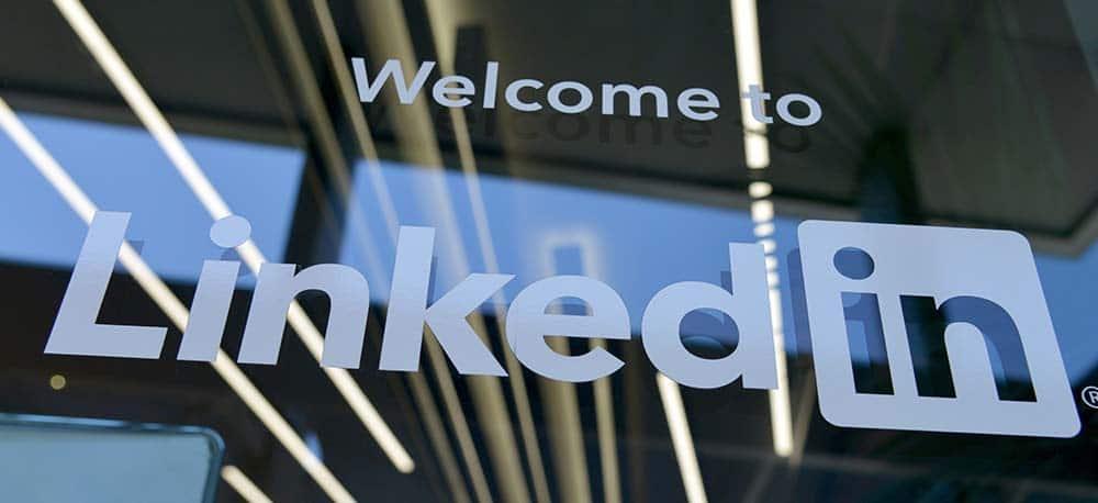 LinkedIn Logo Sign on Glass Door - LinkedIn Tips